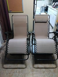 two gray-and-black lounge chairs
