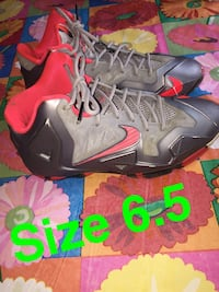 pair of black-and-red Nike basketball shoes Troy, 12182