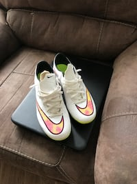 pair of white Nike cleats Arlington, 22204