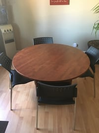 round brown wooden table with four chairs dining set St Albert, T8N 2Y2
