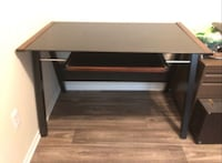 Brown and black wooden computer desk