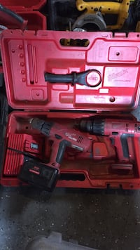 red and black Milwaukee cordless drill 160 mi