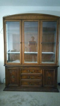 brown wooden framed glass china cabinet Ocala, 34474