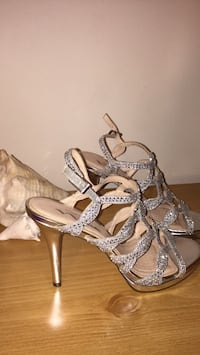 Pair of silver-colored open-toe heels 253 mi