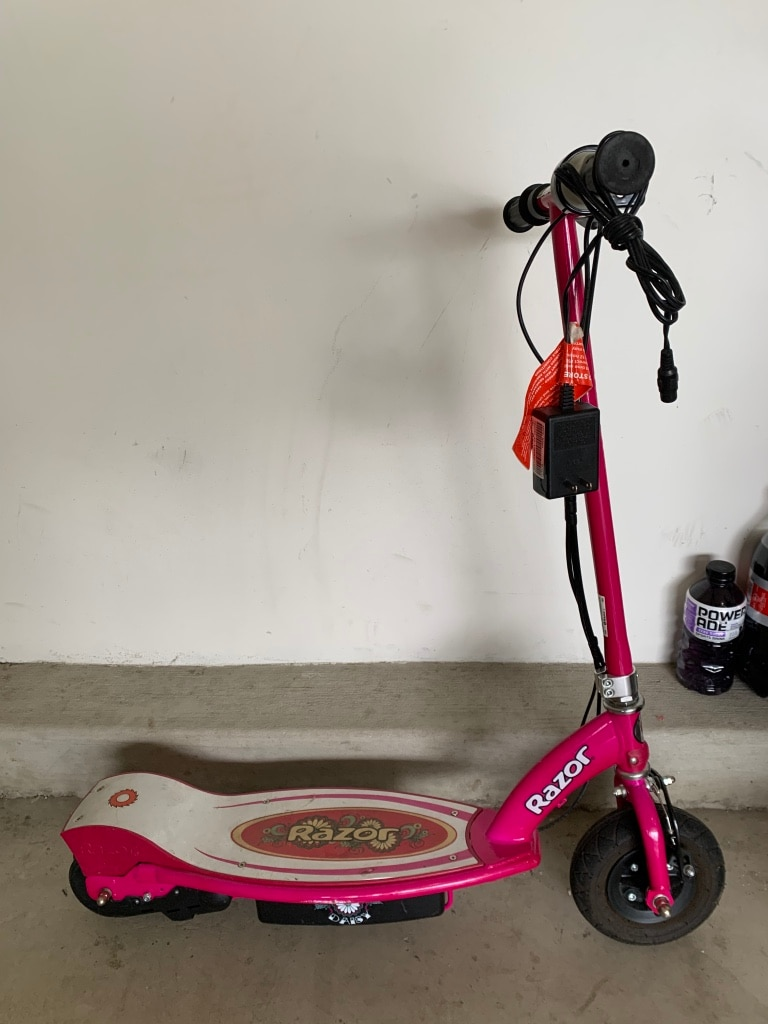 Photo Girls razor electric scooter with charger runs great