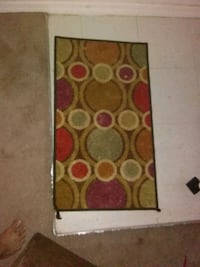 brown and red floral area rug Ocala, 34475