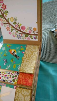 two assorted-color-and-print board decors Calgary, T3A 3H1