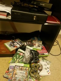 XBOX 360 CONSOLE WITH KINET GAMES AND CONTROLLERS 166 mi