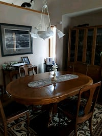 oval brown wooden oak dining table with chairs set Calgary, T3A 5J5
