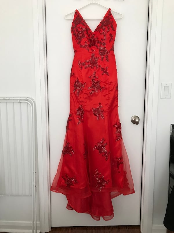 Red Prom sleeveless dress. 19515641-5570-442e-8672-f7e919750e6c