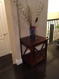 square brown wooden side table with blue glass vase