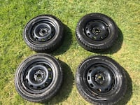 """Winter tires- mint condition 15"""" with rim"""