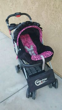 baby's black and pink stroller Rancho Cucamonga, 91701