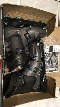 pair of black-and-gray inline skates and box