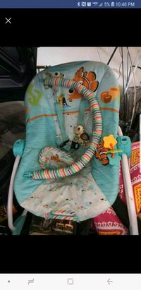 baby's teal and multicolored bouncer El Paso, 79936