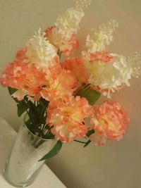 orange artificial carnation flowers and white lilac flowers centerpiece Kitchener, N2R 1P6