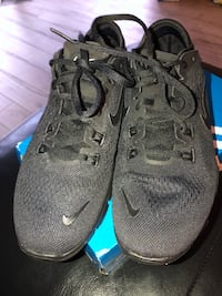 pair of black Nike running shoes Newmarket, L3Y 5C6