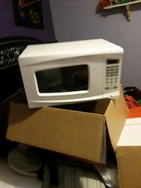 white and black microwave oven 1485 mi