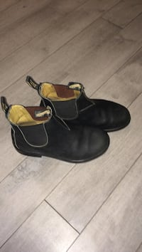 Pair of black leather blundstones shoes