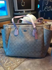 It is like new coach diaper bag are you could use