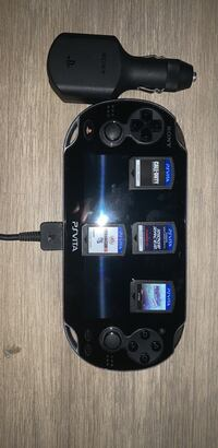 PSVITA With Car Charger, PSVITA Carrying Case, And 5 Games
