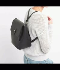 gray and black leather backpack screenshot London, SW8 4AX