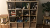 White wooden cubby shelf with assorted books Toronto, M6J 0B7