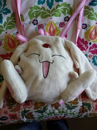 white and pink plush backpack
