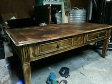 brown wooden table with drawers