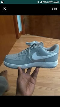 Paired of gray and white Nike low-top sneaker sc