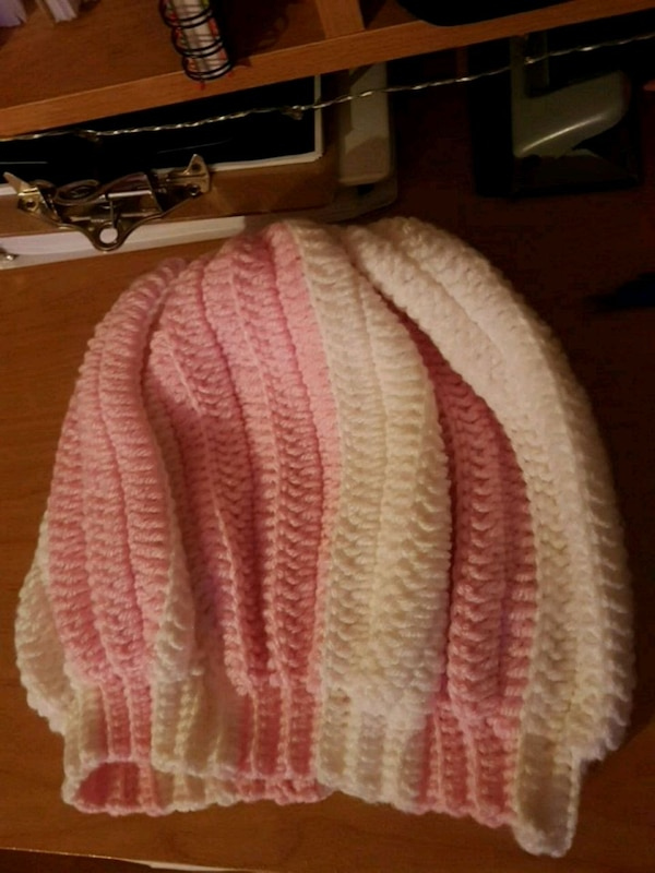 white and pink knitted textile
