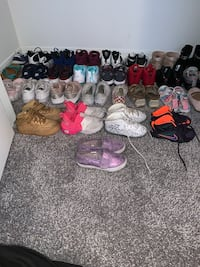 Assorted pairs of shoes and sandals pick up only