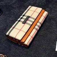 white, black, and red Burberry leather tri-fold wallet Vancouver, V6P 2T8