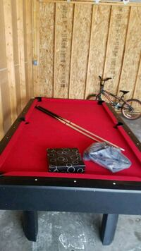 8 ball table and ping pong table