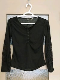New Thin black shirt size xs with lace on sleeves bought to small