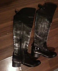 pair of black leather thigh-high boots