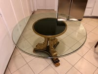round glass top table with black metal base 2276 mi