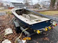 Day sailor boat and trailer that comes with it
