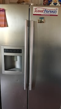 Stainless steel side-by-side refrigerator with dispenser Stockbridge