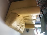 brown leather padded sofa chair null