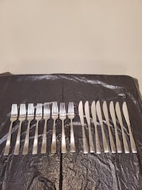 STAINLESS DINNERWARE EATING UTENSILS - Thirty-One (31) Pieces.
