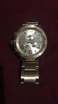 round silver-colored Nixon chronograph watch with link bracelet