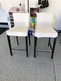 two white padded chairs with black wooden frames Los Angeles, 90034