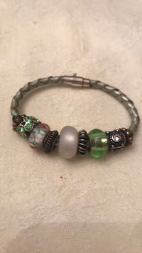 Beautiful charm bracelet with silver locks and leather strap. Perfect gift to a lovely person  Toronto, M8Y 1N6