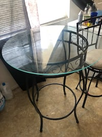 Glass table with stools