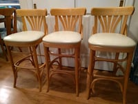 four brown wooden framed white leather padded chairs 27 km