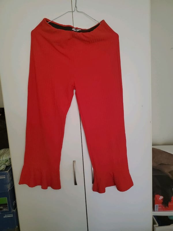 Red Pants (size small but could fit in medium size 28134fbb-011c-4948-843e-a820c89fe0c2