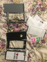 black Nintendo DS with game cases 旧金山, 94124