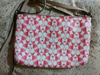 white and red Coach sling bag