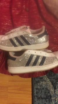 pair of silver sequin Adidas low tops sneaker